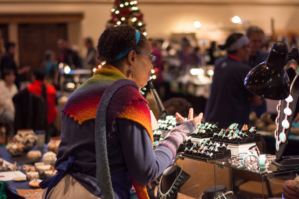 A visitor scans the merchandise at the SWAIA Winter Indian Market // (credit: SWAIA, Terrance Clifford)